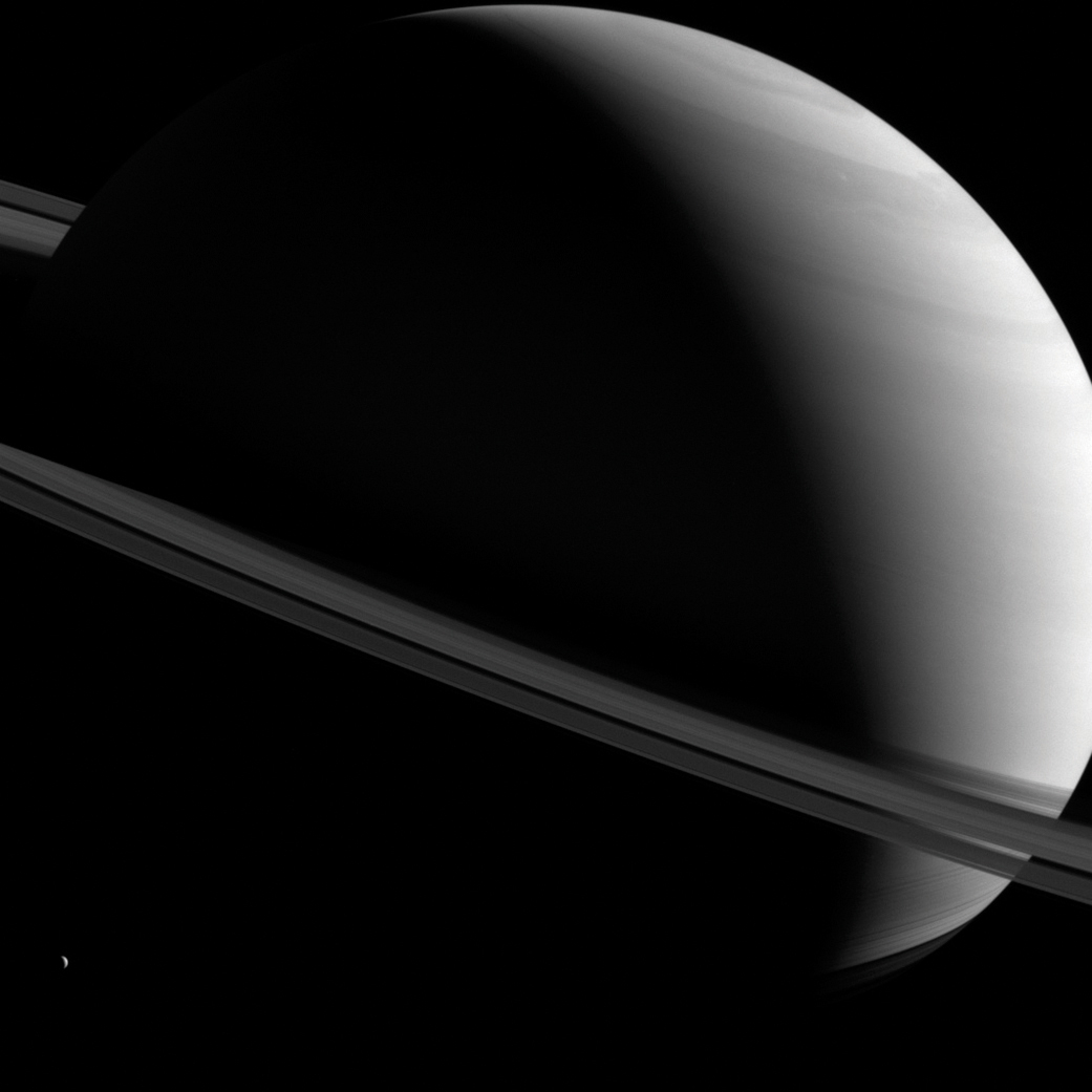 A deep space photo of Saturn and its rings