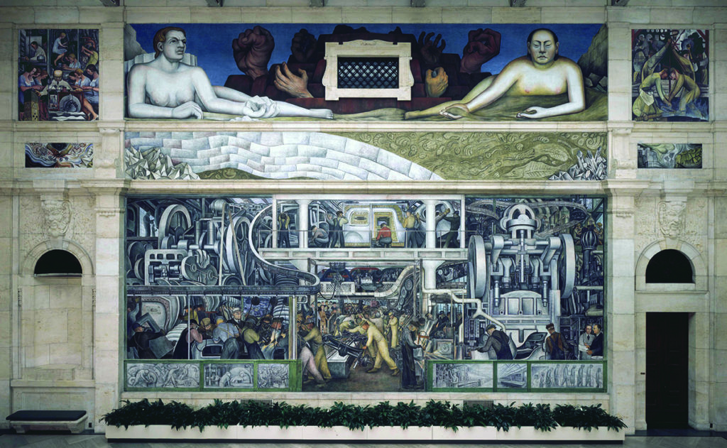 A Detroit mural shows auto workers in a factory and hands reaching up from bricks