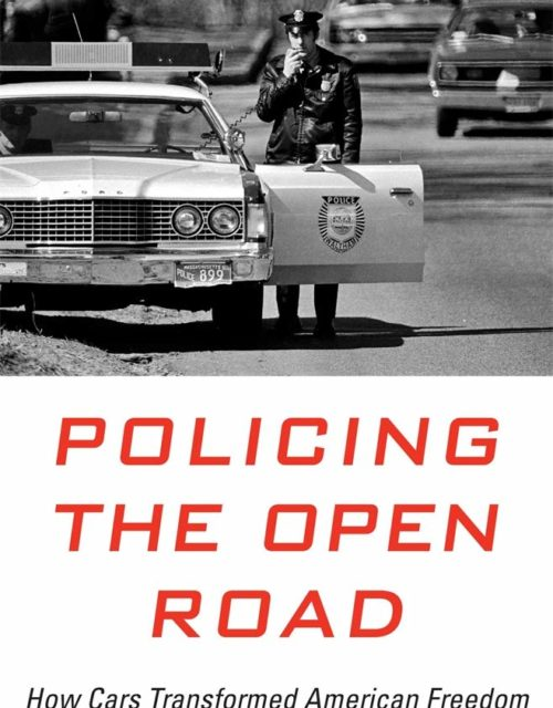 Policing the Open Road Cover: Police officer on his radio standing outside his car